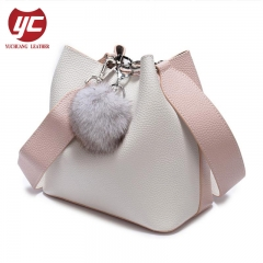 Contrast Color First Layer Leather Ladies Bucket Bags with Fur Ball