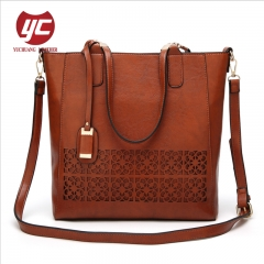 China manufacturer good quality perforated PU leather lady tote bag shopper bag